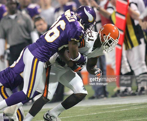 Minnesota Vikings cornerback Antoine Winfield tackles wide receiver Antonio Bryant during a game against the Cleveland Browns on November 27 2005 in...