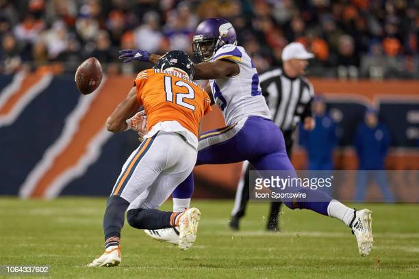 Minnesota Vikings cornerback Xavier Rhodes battles with Chicago Bears wide receiver Allen Robinson to knock the football out in action during a NFL...