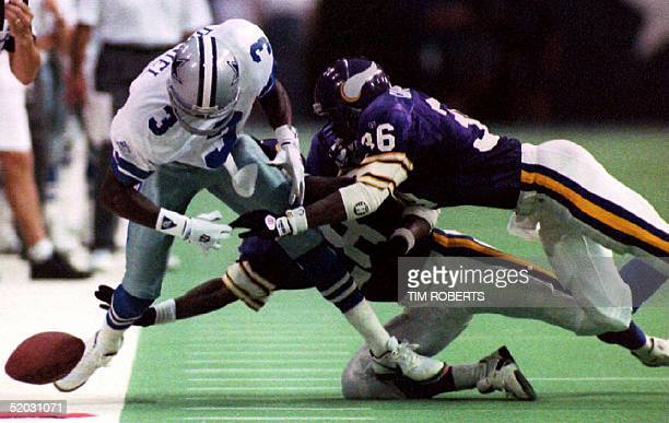 Minnesota Vikings defenders Ron Carpenter and Izel Jenkins break up a pass meant for Dallas Cowboys receiver Tim Daniel during first half action of...