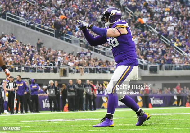 Minnesota Vikings defensive end Brian Robison celebrates a sack by catching an imaginary fish during a NFL game between the Minnesota Vikings and...