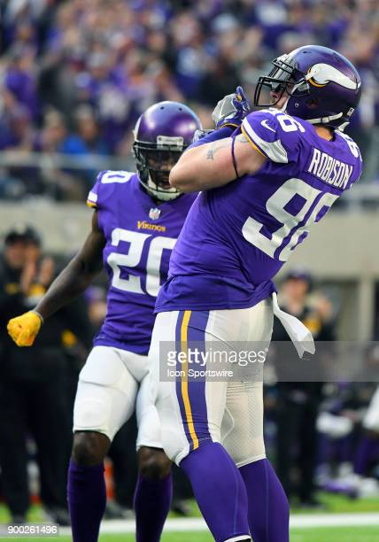 Minnesota Vikings defensive end Brian Robison hooks an imaginary fish after registering a sack during a NFL game between the Minnesota Vikings and...