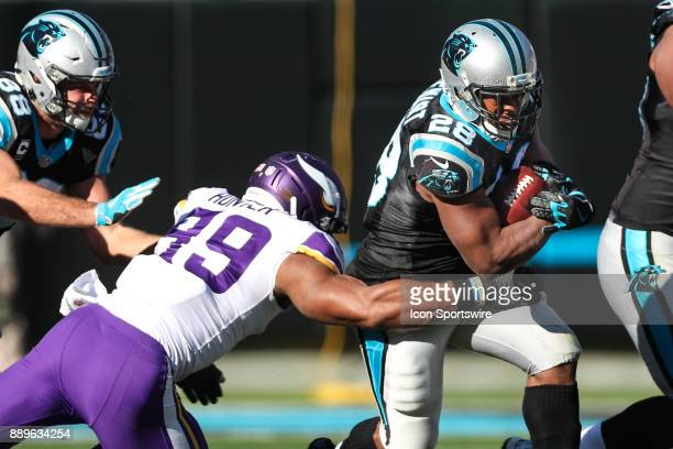Minnesota Vikings defensive end Danielle Hunter gets a hand on Carolina Panthers running back Jonathan Stewart during the first half on December 20...