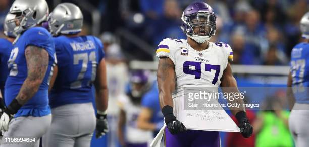 Minnesota Vikings defensive end Everson Griffen pulled his shirt from under his jersey with a message about the birth of is son after sacking Detroit...