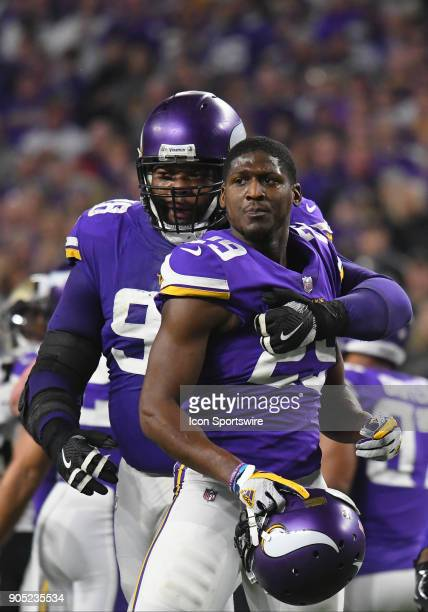Minnesota Vikings defensive tackle Linval Joseph restrains Minnesota Vikings cornerback Xavier Rhodes after New Orleans Saints wide receiver Michael...