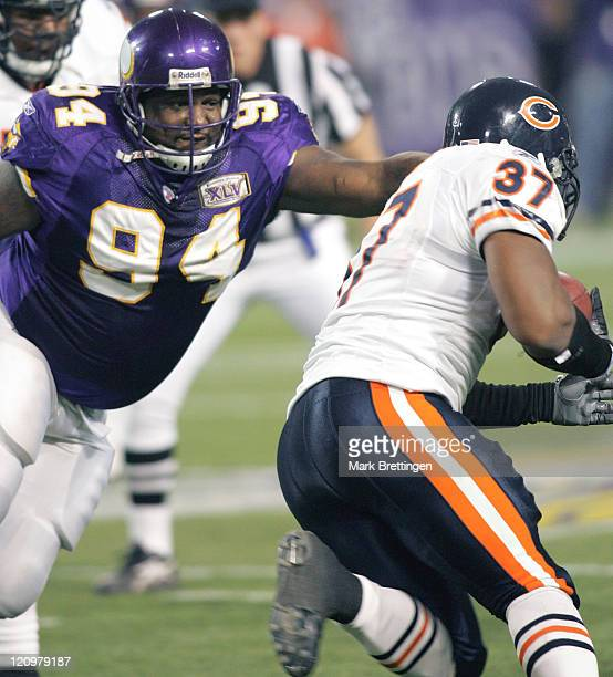 Minnesota Vikings defensive tackle Pat Williams reaches for fullback Jason McKie during a game against the Chicago Bears on January 1 2006 in the...