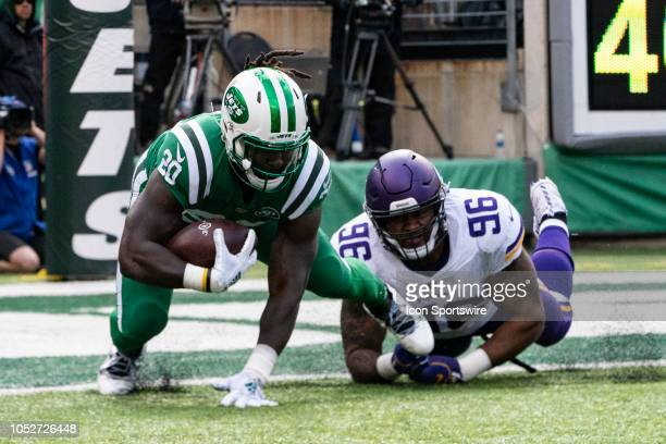 Minnesota Vikings Defensive Tackle Tom Johnson tackles New York Jets Running Back Isaiah Crowell during the first half of the game between the...