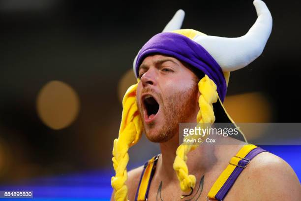 Minnesota Vikings fan cheers in the stands during the first half against the Atlanta Falcons at MercedesBenz Stadium on December 3 2017 in Atlanta...