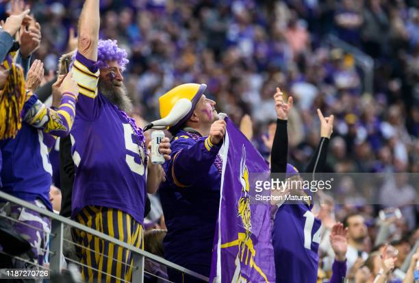 Minnesota Vikings fans cheer after a converted extra point in the first quarter of the game against the Detroit Lions at US Bank Stadium on December...