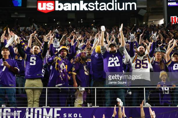 Minnesota Vikings fans cheer after a touchdown against the New Orleans Saints in the NFC Divisional Playoff game at US Bank Stadium on January 14...