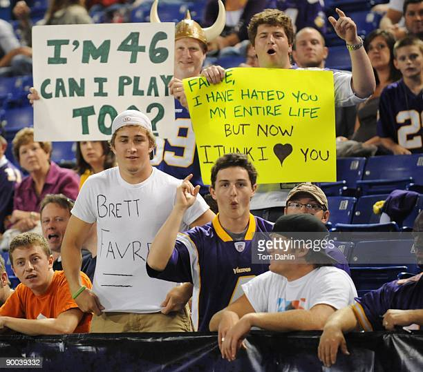 Minnesota Vikings fans display Brett Favre signs during an NFL game against the Kansas City Chiefs at the Hubert H. Humphrey Metrodome on August 21,...