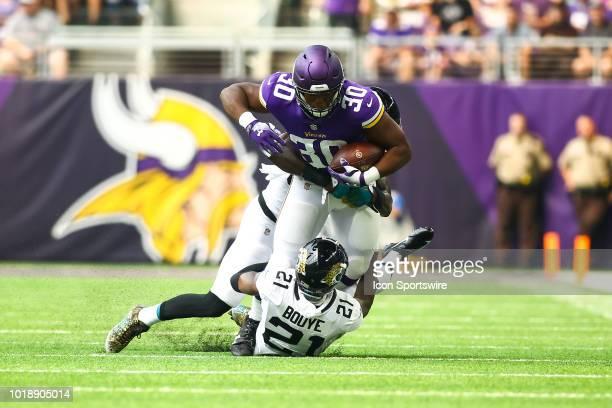 Minnesota Vikings fullback CJ Ham is tackled by Jacksonville Jaguars defensive back AJ Bouye during the preseason game between the Jacksonville...