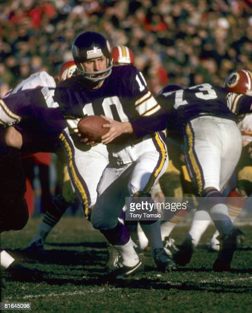 Minnesota Vikings Hall of Fame quarterback Fran Tarkenton prepares to hand off during the NFC Divisional Playoff a 3520 victory over the Washington...