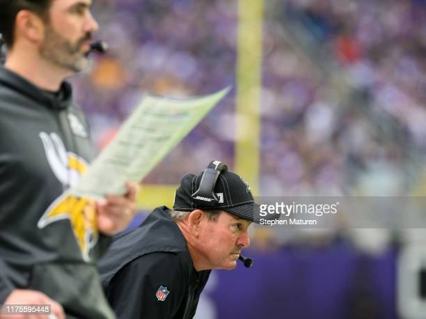 Minnesota Vikings head coach Mike Zimmer looks on as offensive coordinator Kevin Stefanski calls a play in the first quarter of the game agains the...