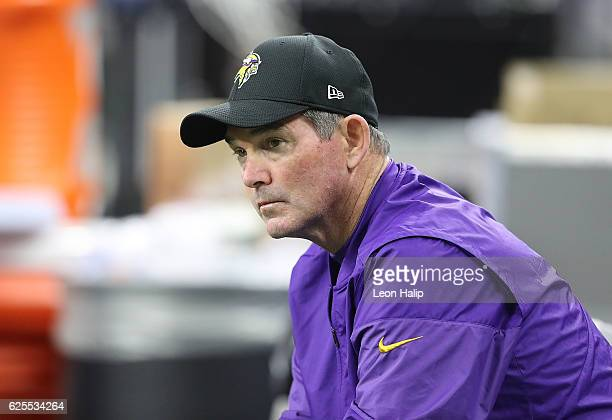 Minnesota Vikings head coach Mike Zimmer watches the action prior to the start of the Thanksgiving day game against the Detroit Lions at Ford Field...