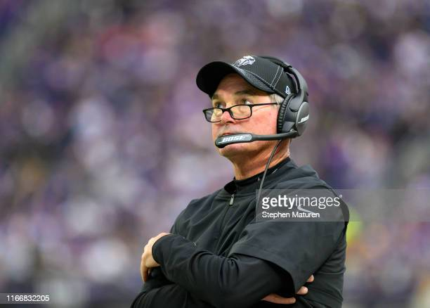 Minnesota Vikings head coach Mike Zimmer watches the replay board after throwing a challenge flag in the third quarter of the game against the...