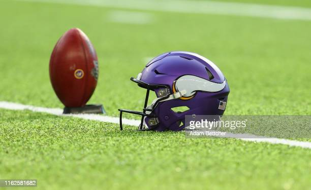 Minnesota Vikings helmet and ball on the field before the pre-season game against the Seattle Seahawks at U.S. Bank Stadium on August 18, 2019 in...