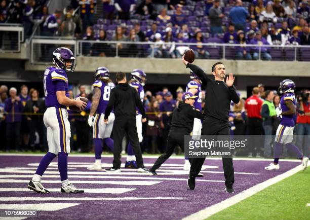 Minnesota Vikings interim offensive coordinator Kevin Stefanski throws a ball during warmups before the game against the Chicago Bears at US Bank...