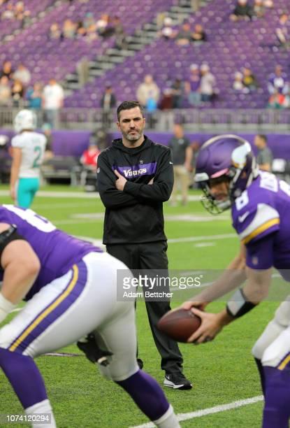 Minnesota Vikings interim offensive coordinator Kevin Stefanski looks on as Kirk Cousins of the Minnesota Vikings warms up before the game against...
