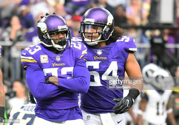 Minnesota Vikings linebacker Eric Kendricks taps Minnesota Vikings cornerback Terence Newman on the head after a tackle for a loss during a NFL game...