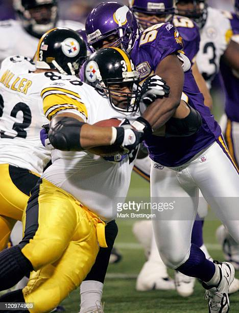 Minnesota Vikings linebacker Sam Cowart stops Jerome Bettis during a game against the Pittsburgh Steelers on December 18, 2005 in the Metrodome in...