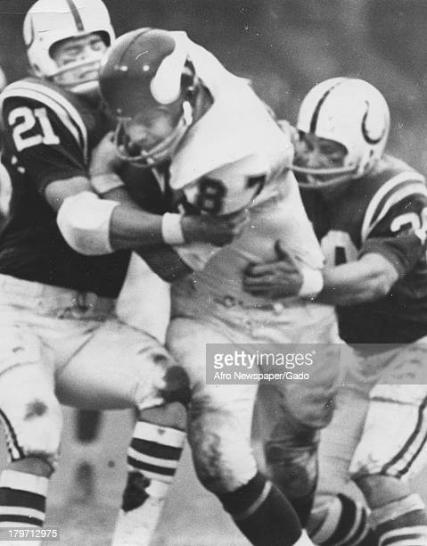 Minnesota Vikings offensive end John Beasley runs into Baltimore defenders Rick Volk and Jerry Logan during the Colts' 219 National Football League...