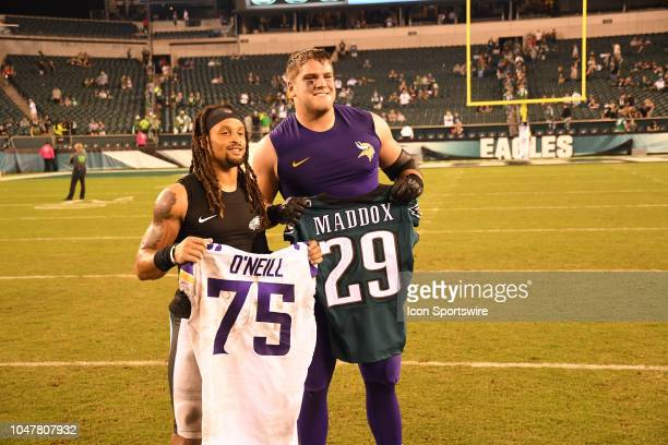 Minnesota Vikings Offensive Tackle Brian O'Neill and Philadelphia Eagles Cornerback Avonte Maddox swap jerseys after the football game between the...