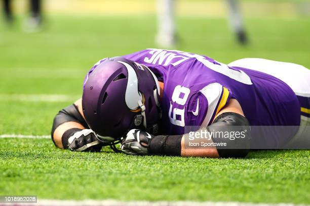 Minnesota Vikings offensive tackle Cedrick Lang lays down injured in the 4th quarter during the preseason game between the Jacksonville Jaguars and...