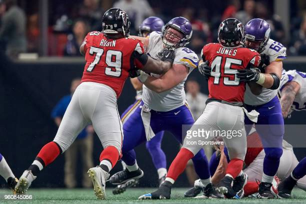 Minnesota Vikings offensive tackle Rashod Hill and Minnesota Vikings center Nick Easton battle with Atlanta Falcons defensive tackle Ahtyba Rubin and...