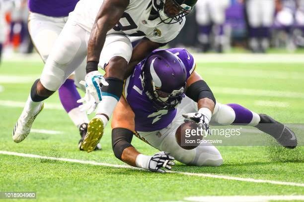 Minnesota Vikings offensive tackle Riley Reiff recovers a fumble during the preseason game between the Jacksonville Jaguars and the Minnesota Vikings...