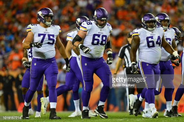 Minnesota Vikings players from ]eft offensive tackle Brian O'Neill offensive tackle Cedrick Lang and center Josh Andrews line up against the Denver...