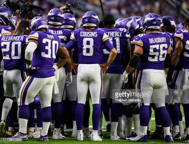 Minnesota Vikings players huddle up on the field before the game against the Atlanta Falcons at US Bank Stadium on September 8 2019 in Minneapolis...