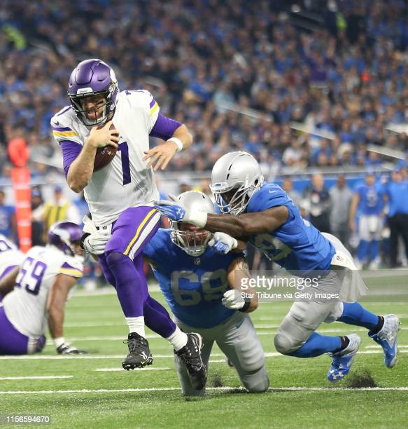 Minnesota Vikings quarterback Case Keenum broke the tackle of Detroit Lions defensive end Anthony Zettel and linebacker Tahir Whitehead for a second...