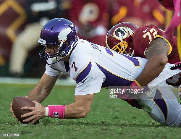 Minnesota Vikings quarterback Christian Ponder is sacked by Washington Redskins defensive end Stephen Bowen during the first half at FedEx Field in...