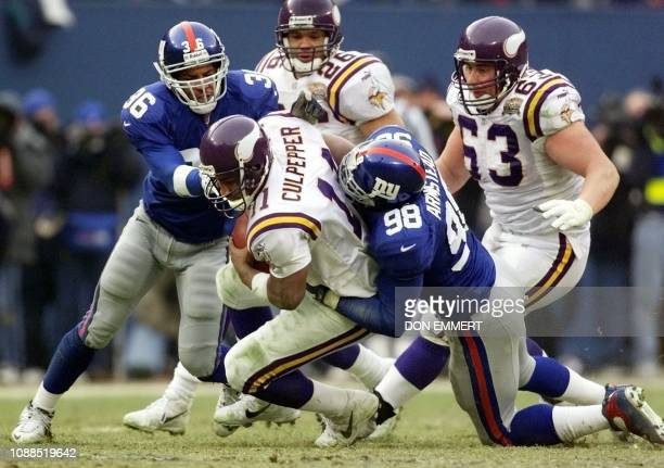 Minnesota Vikings quarterback Dante Culpepper is sacked by New York Giants Shaun Williams and Jessie Armstead late in the fourth quarter of the NFC...