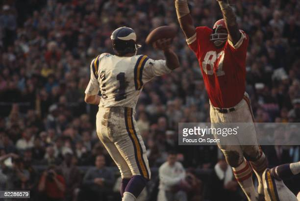 Minnesota Vikings' quarterback Joe Kapp looks to pass over defensive end Aaron brown of the Kansas City Chiefs during Super Bowl IV at Tulane Stadium...