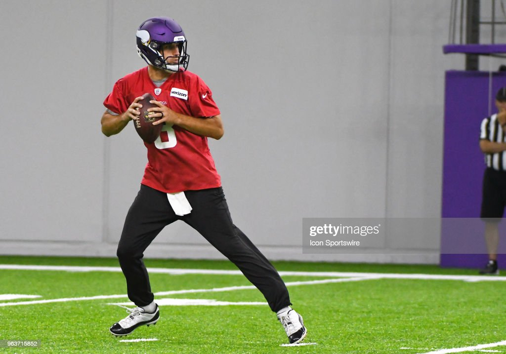 Minnesota Vikings quarterback Kirk Cousins (8) drops back during Optional Team Activities on May 30, 2018 at Twin Cities Orthopedics Performance Center in Eagan, MN.