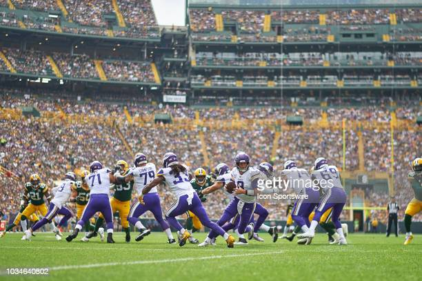 Minnesota Vikings Quarterback Kirk Cousins handles the football after taking the snap in action during an NFL game between the Minnesota Vikings and...