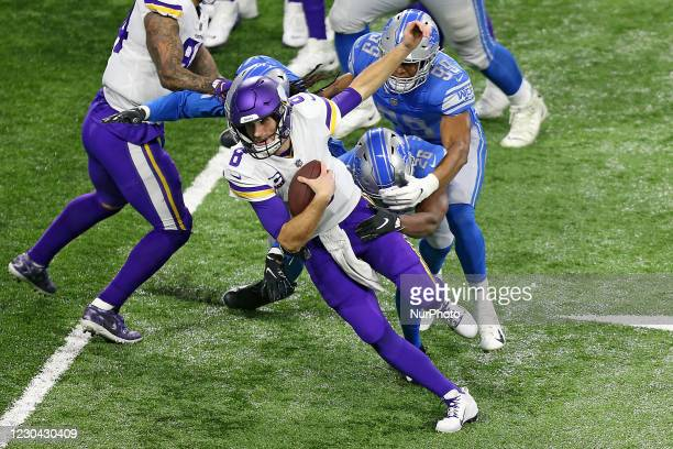 Minnesota Vikings quarterback Kirk Cousins is pursued by Detroit Lions defensive end Julian Okwara , Detroit Lions linebacker Jalen Reeves-Maybin ,...