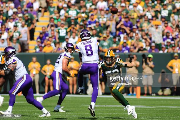 Minnesota Vikings quarterback Kirk Cousins passes over the oncoming rush of Green Bay Packers linebacker Clay Matthews during a game between the...