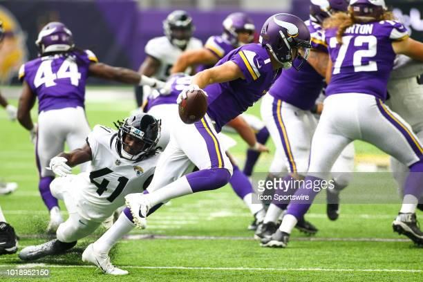 Minnesota Vikings quarterback Kyle Sloter avoids a tackle from Jacksonville Jaguars cornerback Tre Herndon in the 4th quarter during the preseason...