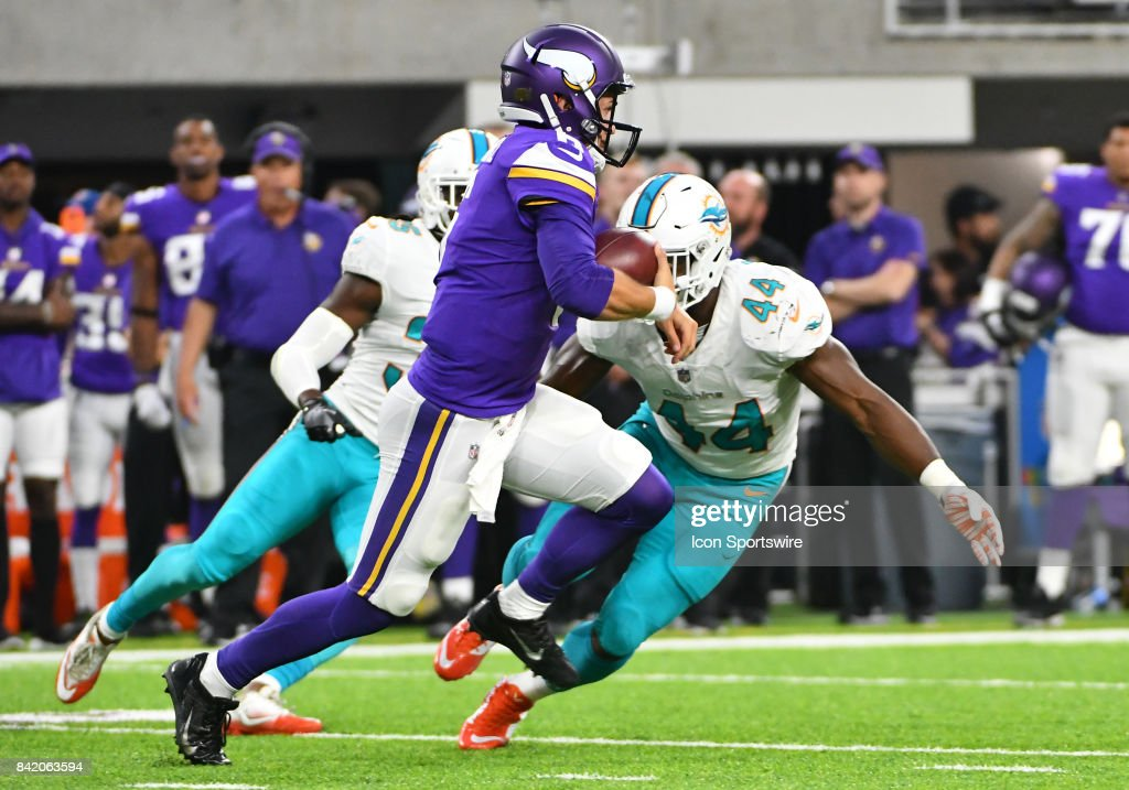 Minnesota Vikings quarterback Taylor Heinicke (6) tries to avoid Miami Dolphins linebacker Deon Lacey (44) during a NFL preseason game between the Minnesota Vikings and Miami Dolphins on August 31, 2017 at U.S. Bank Stadium in Minneapolis, MN. The Dolphins defeated the Vikings 30-9.