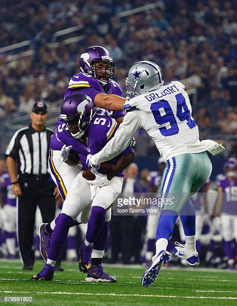 Minnesota Vikings quarterback Teddy Bridgewater is tackled by Dallas Cowboys defensive end Randy Gregory during the NFL preseason game between the...