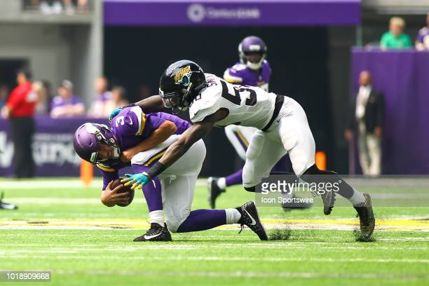 Minnesota Vikings quarterback Trevor Siemian is sacked by Jacksonville Jaguars linebacker Telvin Smith during the preseason game between the...