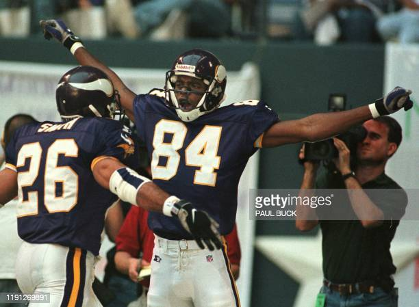 Minnesota Vikings receiver Randy Moss celebrates his 51 yard touchdown reception on the fourth play of the game versus the Dallas Cowboys at Texas...