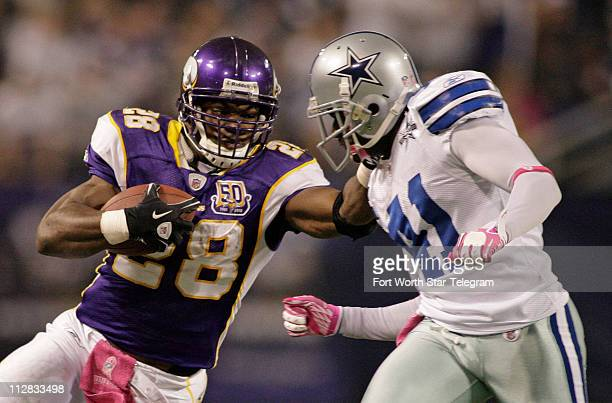 Minnesota Vikings running back Adrian Peterson pushes Dallas Cowboys cornerback Terence Newman on a 3rd quarter run The Vikings defeated the Cowboys...