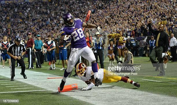 Minnesota Vikings Running Back Adrian Peterson Scores A Touchdown Past Washington Redskins Cornerback Josh Wilson During