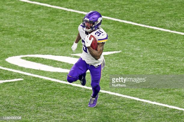 Minnesota Vikings running back Ameer Abdullah carries the ball during the second half of an NFL football game between the Detroit Lions and the...