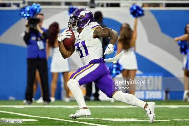 Minnesota Vikings running back Ameer Abdullah runs the ball for yardage during the first half of an NFL football game against the Minnesota Vikings...