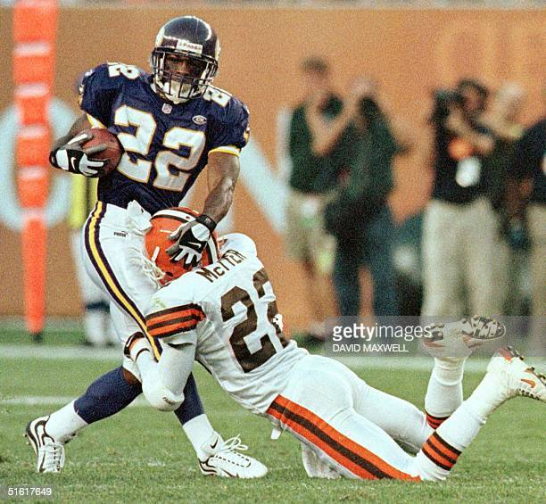 Minnesota Vikings running back David Palmer is tackled by Cleveland Browns defensive back Tim McTyer during the first quarter of the Browns game with...