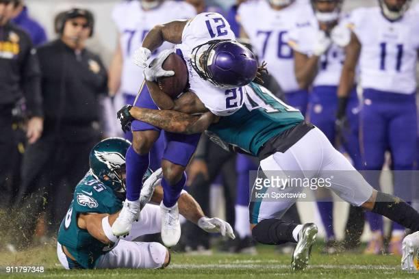 Minnesota Vikings running back Jerick McKinnon battles with Philadelphia Eagles outside linebacker Mychal Kendricks and Philadelphia Eagles...